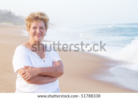 elderly woman on beach - stock photo
