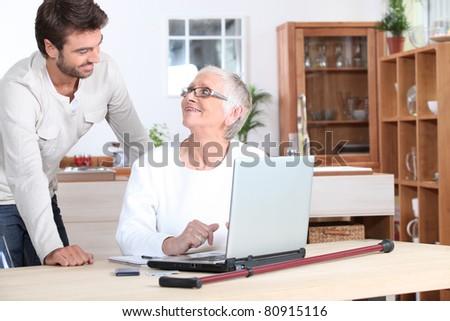 Elderly woman on laptop - stock photo