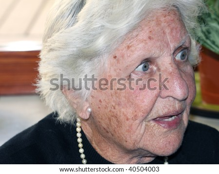 elderly woman portrait with a stunned expression on her face - stock photo