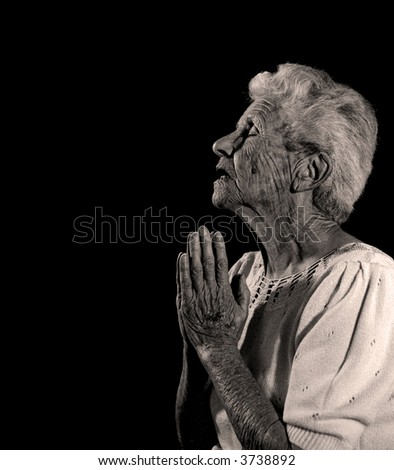 Elderly Woman Praying to God For Forgiveness