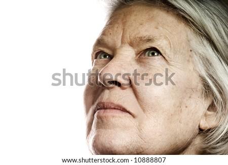 Elderly woman's portrait. Isolated on white background - stock photo