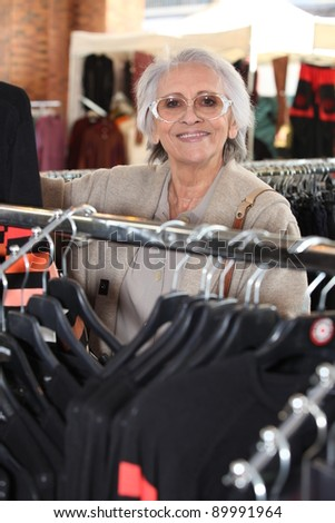 Elderly woman shopping - stock photo