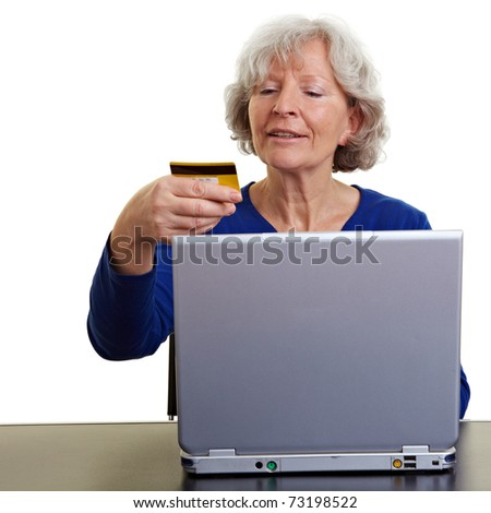 Elderly woman shopping online with laptop and credit card - stock photo