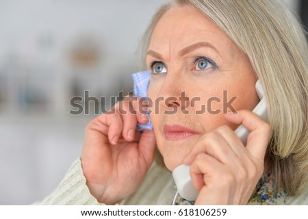 Elderly woman sick and calling on the phone