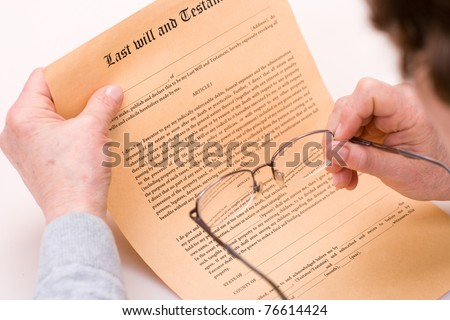 elderly woman signing testament - stock photo