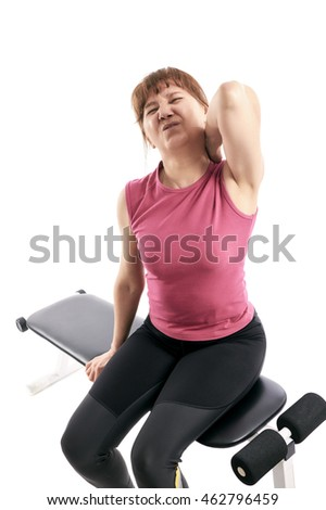 Elderly woman sitting on the bench, holding sore shoulder with hand touching or massaging in workout stress, body pain and health problem, isolated on white background.