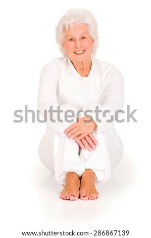 elderly woman sitting on the floor - stock photo