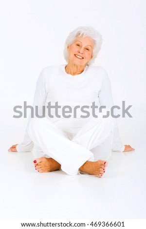 elderly woman sitting on the floor