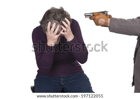 elderly woman under attack by knife or gun - stock photo