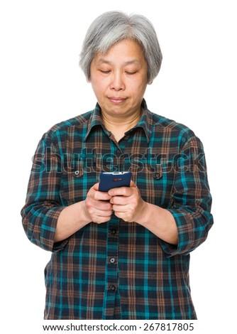 Elderly woman use of smartphone - stock photo
