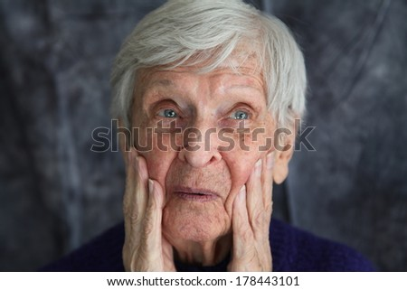 elderly woman who is surprised - stock photo
