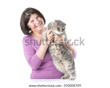 Elderly woman with a cat. Studio photography on a white background. Isolated. - stock photo