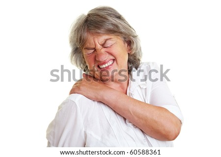 Elderly woman with gray hair holding her aching back - stock photo