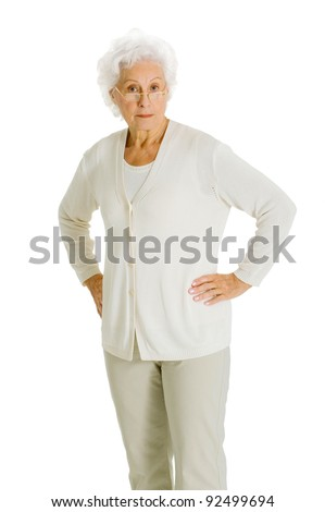 elderly woman with hands on hips - stock photo