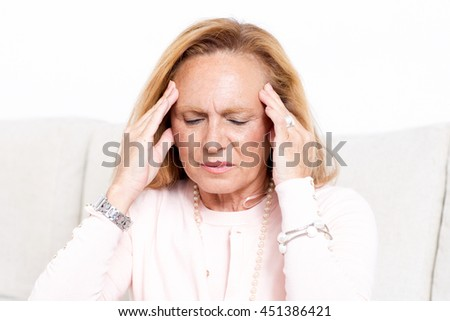 Elderly woman with headache - stock photo