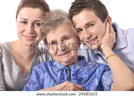 Elderly woman with her grandchildren - stock photo