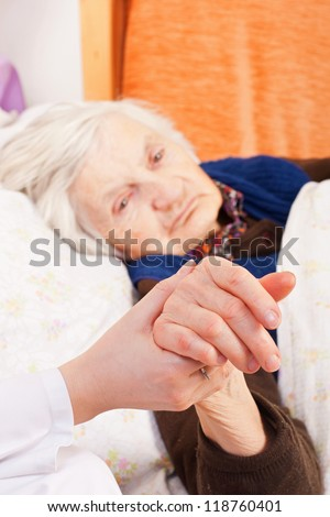 Elderly woman with the young doctor - stock photo
