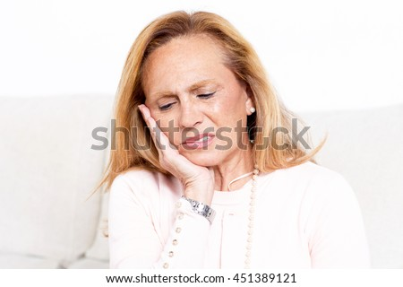Elderly woman with toothache - stock photo