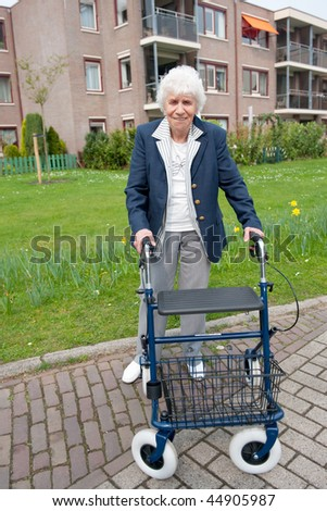 elderly woman with walker friendly smiling