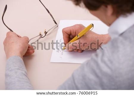 elderly woman writing letter - stock photo