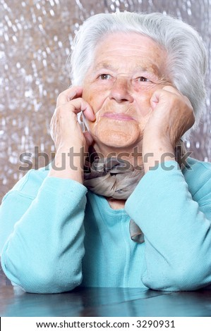 Elderly woman (91 year old) bringing back memories - stock photo