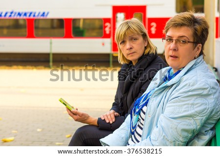 Elderly women while traveling on the station - stock photo