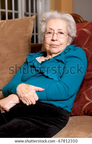 Elderly 80 year old woman in a home lifestyle scene. - stock photo