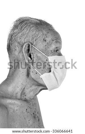 elderty man wearing mask,black and white tone - stock photo