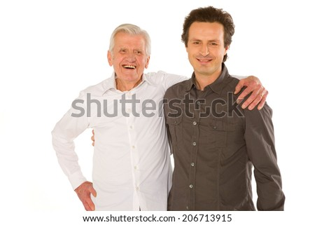 eldery father granfather and son standing  on white backgraund - stock photo