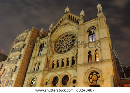 Eldridge Street Synagogue at night in New York City, one of the oldest surviving synagogues in the united states.
