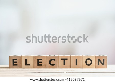 Election sign made of wooden blocks on a table - stock photo