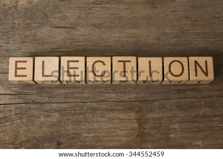 ELECTION text on a wooden background - stock photo
