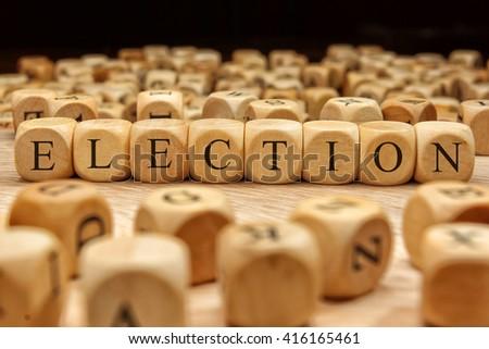 ELECTION word written on wood block - stock photo