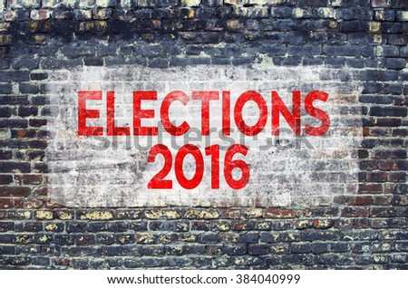 Elections 2016 text on brick wall - stock photo