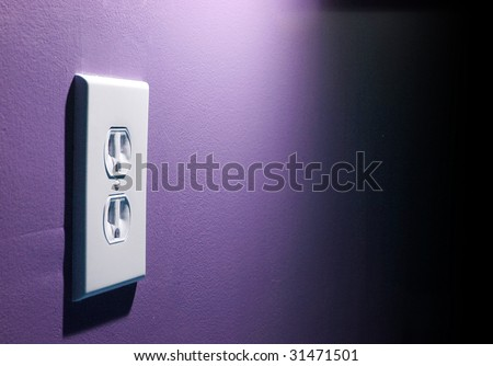 Electircal socket on a dynamically lit wall.  Highly textured in purple