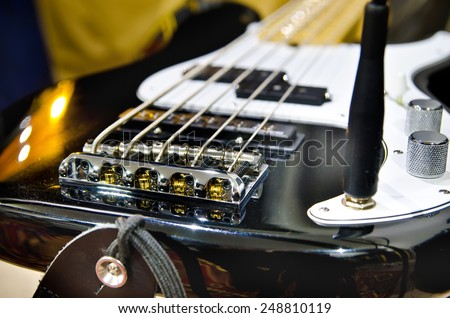 electric bass guitar in a studio closeup - stock photo