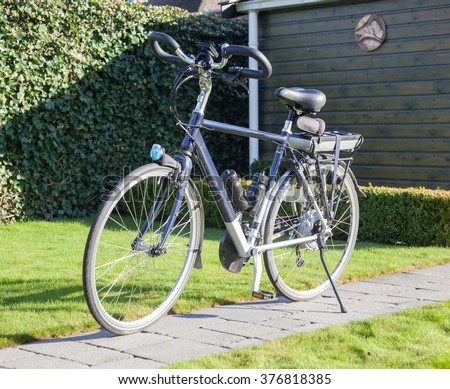 Electric bicycle in the sun, modern bike mostly used by seniors - stock photo