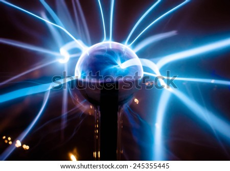 Electric blue beam spread from the middle ball Science dignitaries/ Electric blue light / Electric blue beam spread from the middle ball Science dignitaries. Close up  (electric, power, science ) - stock photo