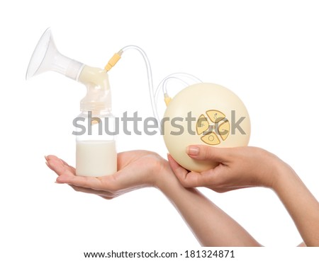 Electric breast pump to increase milk supply for breastfeeding mother and child feeding bottle with breastmilk isolated on white background - stock photo