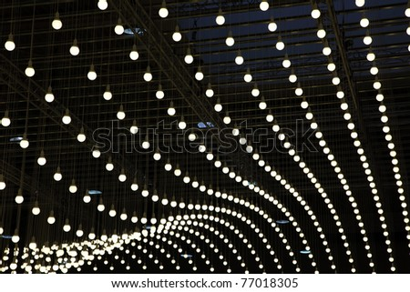 Electric bulbs hanging on a ceiling - stock photo
