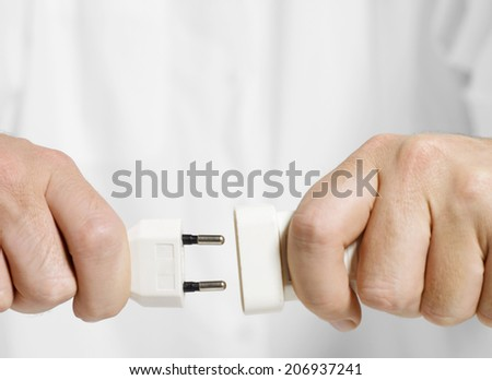 Electric cable with hand - stock photo