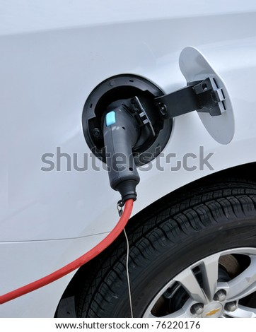 Electric car at charge point - stock photo