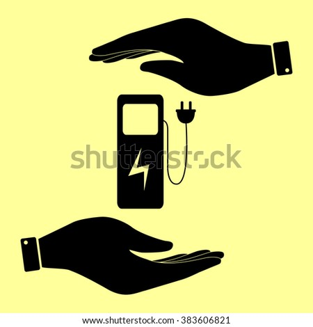 Electric car charging station sign. Save or protect symbol by hands. - stock photo