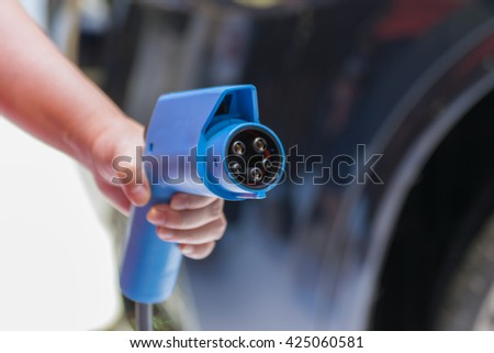 Electric car charging vehicle energy power for environment friendly - stock photo