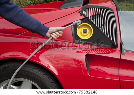 Electric car home refueling - stock photo