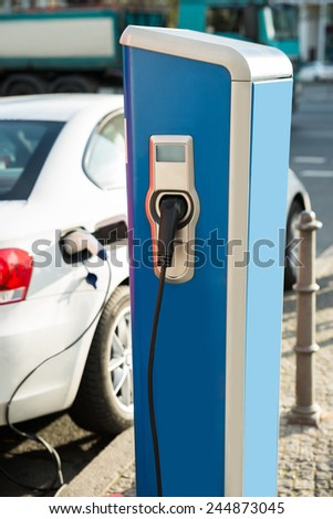 Electric Car Is Being Recharged At A Power Station - stock photo