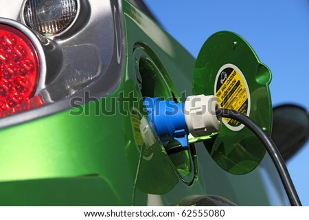 electric car refuel with power - stock photo