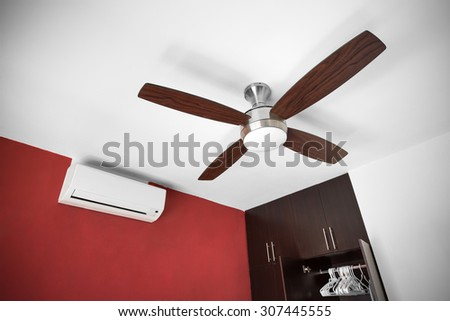 Electric ceiling fan at the room - stock photo