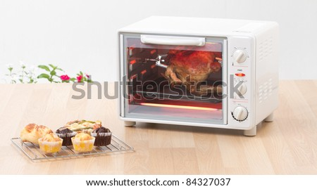 Electric chicken grill or roaster oven fast and convenience to cooking - stock photo