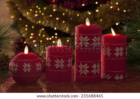 electric christmas candles in atmospheric light - stock photo